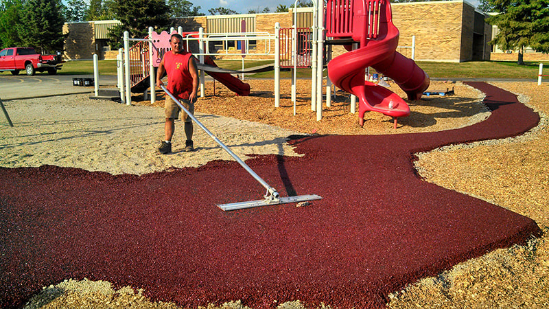 applying porous pave to a playground area